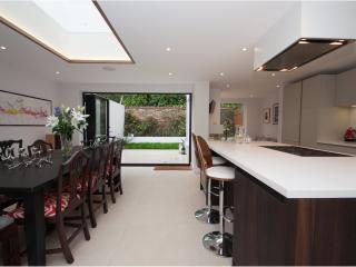 Spacious and modern four-bed townhouse with private garden., Londen