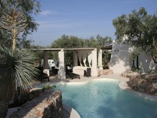 Modern Pool And Ancient Trullo