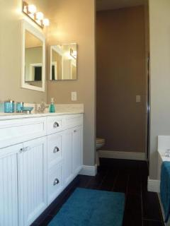 Master bath is complete with double sinks, Roman tub and a separate shower.
