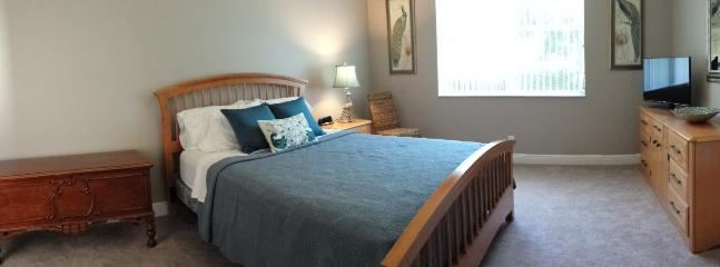 Master bedroom has a comfy queen bed with luxury linens.