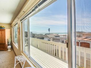 Ocean views, a deck & firepit, just 50 feet from the beach!