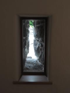 Window created from original slit in traditional barn before conversion