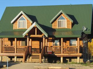 Front View of Cabin in the afternoon. Aspen grove in background. Faces Meadow.
