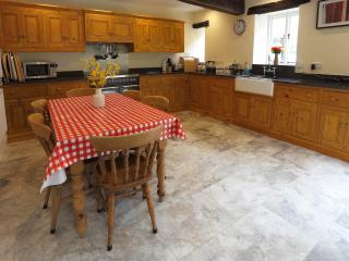 Fully equipped kitchen, underfloor heating, granite work surfaces, butler sink, 2 fridges, freezer
