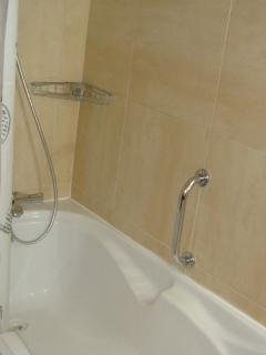 New bath with shower, quality fittings.