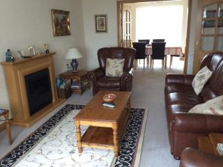 Sitting room with doors leading to dinning kitchen