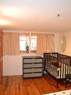 Bedroom #4. Crib pictured.