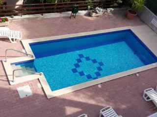 Swimming pool with deck chairs and plenty of room for kids to play