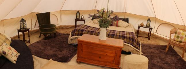 Calon Snowdonia Glamping Tent, a 5mtr bell tent that has many windows and door
