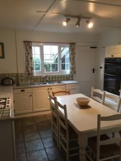Bright kitchen with utility room and larder