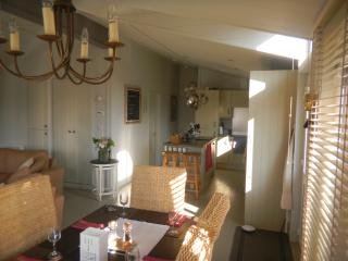 Open plan lounge, dining area and kitchen.