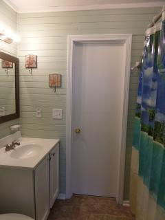 King Bathroom in between downstairs king rooms. Features tub/shower combination