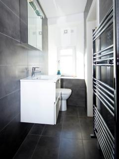 The newly fitted shower room is sleek and modern