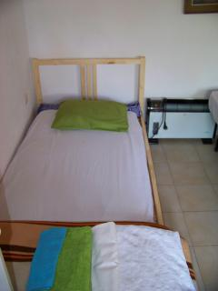 single bed in big bedroom and heating
