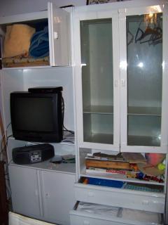 TV / audio set and cupboard with linnen  in big bedroom