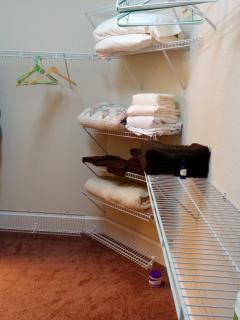 Ample closet space with extra clean linen