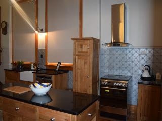 Fully equipped kitchen with old world features and modern appliances.