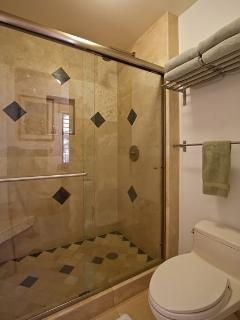 travertine and granite bathrooms with Grohe fixtures