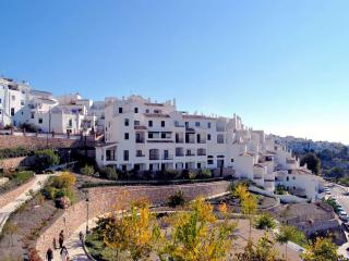 View over the botanical gardens of Frigiliana Heights apartment block.