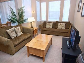 Living Room includes a Flat Screen