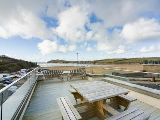 Deck overlooking Porth Beach! Enjoy sunrises, sunsets & beach lunches. Surf store and shower below.
