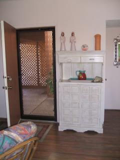 Front Entrance from carport. Filled with Mexican dish ware for your parties.