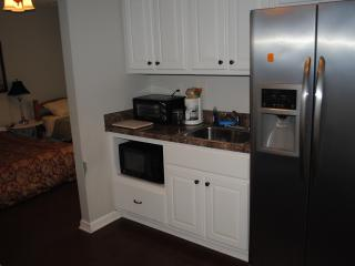 Full fridge/freezer, microwave, coffee maker, and toaster oven