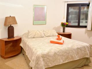 a comfortable Queen size bed in each suite