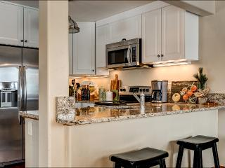 Fully Equipped Kitchen featuring Granite slab counters