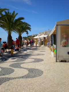 Cafes, restaurants and market stalls on the promenade by the beach