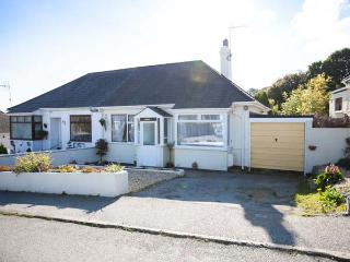 LOWENNA, semi-detached cottage, pet-friendly, enclosed garden, 10 mins to beach,