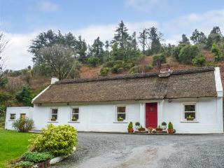 THE THATCH, all ground floor, thatched, open fires, parking, garden, in