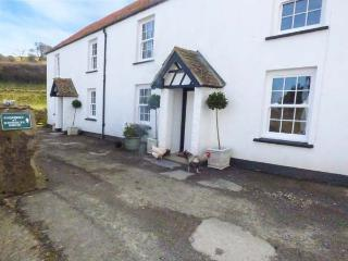 PHEASANT COTTAGE, semi-detached, on working farm, shared private beach, in, Berrynarbor