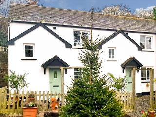 MARTIN COTTAGE, semi-detached, on working farm, shared private beach, in, Berrynarbor