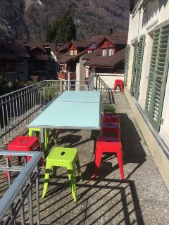 Balcony with seating for 12 and wind out sun cover