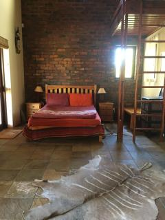 The main guest room has one double bed and three single beds.
