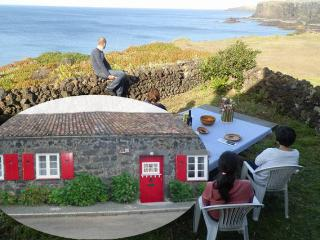 Cottage on Cliffs over the Sea