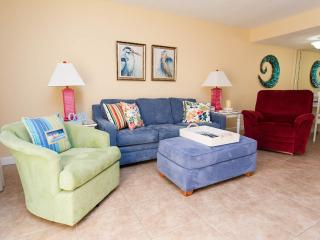 A queen size sleeper sofa. Who couldn't chill in this beachy living room?