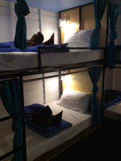 Our comfy air conditioned  dorm room beds each furnished with a privacy curtain, power point & light