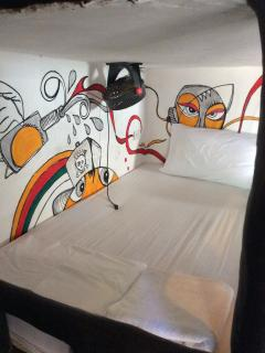 Our comfy air conditioned  dorm room beds each furnished with a power point & reading light.