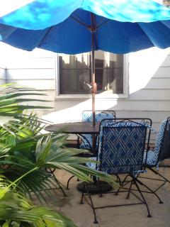 Outdoor dining in the courtyard offers an alternative to the dining room.