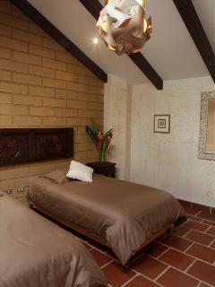 The upstairs bedroom with exposed brick throughout the building.