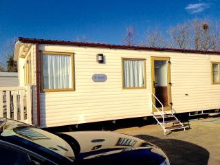 Side view of caravan showing off road parking space