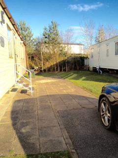 Area to side of caravan is both paved and grassed