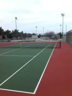 tennis courts behind condo there are fees