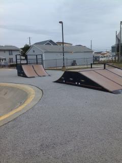 skate boarding behind condo