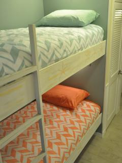 Hallway bunk beds, brand new mattresses, each with own reading light.