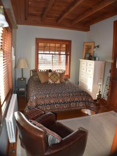 Bedroom with queen bed and a shared bath