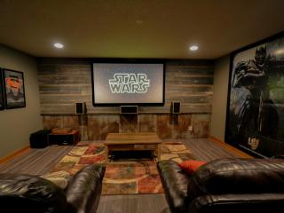 Theater area with premium sound, 100' projection screen and 2 sleeper sofas