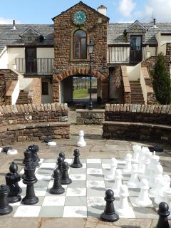 The outdoor chess set at the heart of the village by the old clock tower, putting green, crazy golf